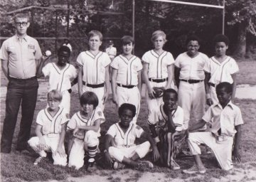 We played Little League in Harlan County.  Your author is on the front row, far left end.